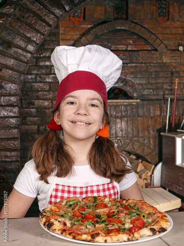 Keuken foto achterwand Pizzeria happy little girl cook with pizza in pizzeria