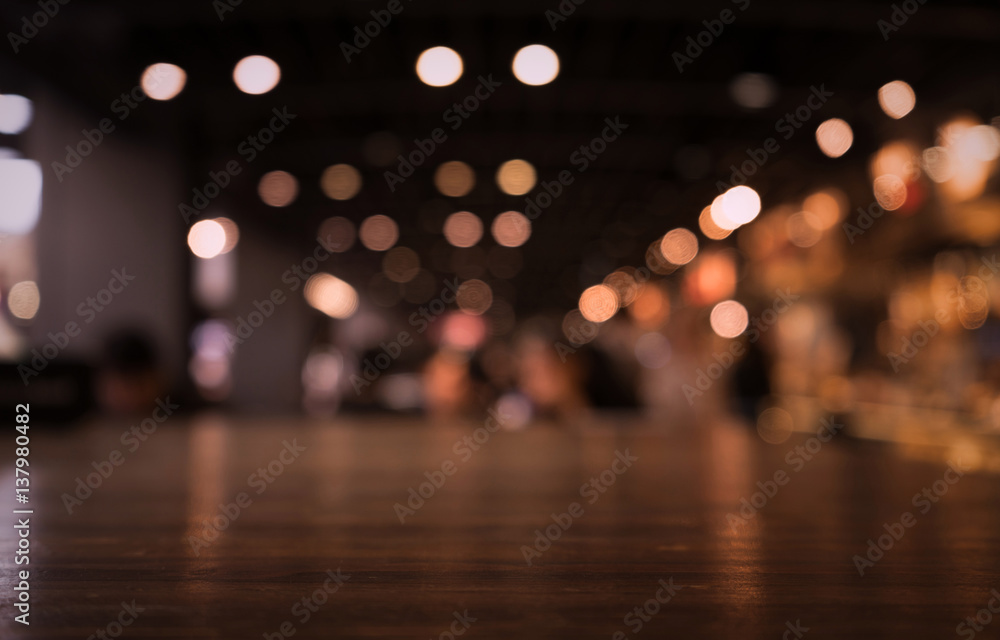 Fototapety, obrazy: Empty wood table top on blur light gold bokeh of cafe restaurant in dark background/selective focus.