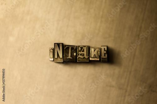 Fotografía  INTAKE - close-up of grungy vintage typeset word on metal backdrop