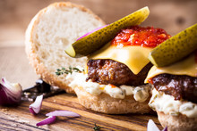 Homemade Beef Burgers With  Pickles, Tartar And Tomato Sauce Serving On Rustic Wooden Board