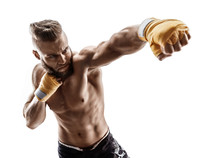Man Throwing A Fierce And Powerful Punch. Photo Of Muscular Man Isolated On White Background. Strength And Motivation.