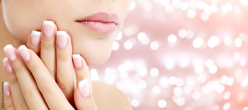 Fototapeta Beautiful young woman with healthy skin and french manicure