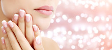 Beautiful Young Woman With Healthy Skin And French Manicure