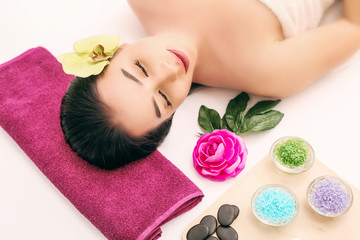 Obraz na płótnie Canvas spa, beauty, people and body care concept - beautiful woman getting face treatment over holidays light background