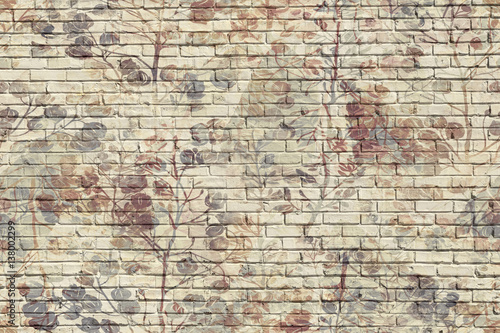 leaves brick wall