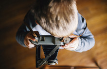 Overhead View Of Boy Using Vintage Camera