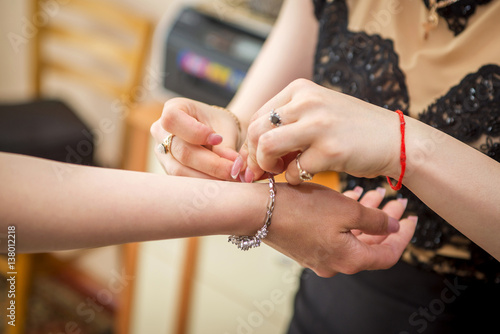 Fototapety, obrazy: girl dresses decoration on her hand close-up
