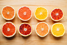 Citrus Fruit Arranged On A Wooden Table And Photographed From Above