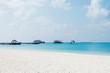 beautiful tranquil beach in blue sunny sky