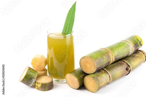 Fotografie, Obraz  Fresh sugar cane juice in glass on white background