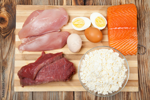 Protein diet, fish, cheese, eggs, meat and chicken on a wooden background Obraz na płótnie