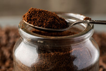 Ground Coffee In Metal Spoon On A Glass Jar
