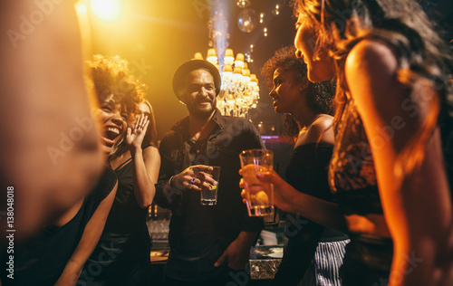 Group of friends enjoying a party at pub