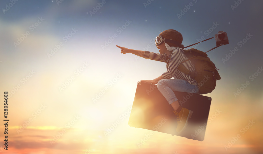 Fototapeta Child flying on a suitcase