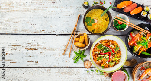 Tuinposter Eten Asian food served on wooden table, top view, space for text