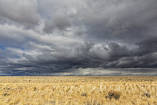 USA, Wyoming, Sweetwater County, Plain With Storm Clouds Along The U.S. Route