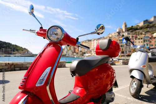Red Vespa in the city Wallpaper Mural