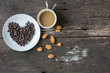 Coffee cup espresso tree in one and coffee beans heart shape background on a wooden table , top view