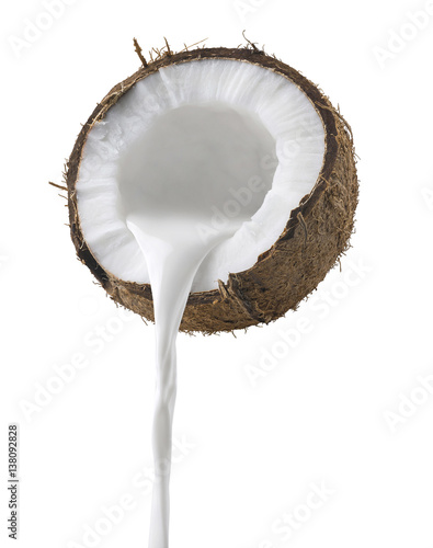 Coconut milk pouring side view isolated on white background