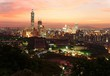 Aerial panorama of downtown Taipei City with Taipei 101 Tower among skyscrapers under dramatic sky ~ A romantic evening in Taipei, the capital city of Taiwan, with beautiful rosy afterglow at sunset