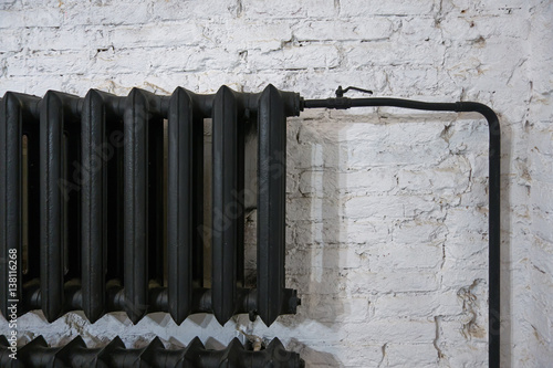 Old Black Cast Iron Radiator On A White Brick Wall Buy