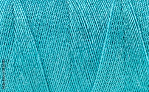 In de dag Macrofotografie Blue thread spooled on a bobbin