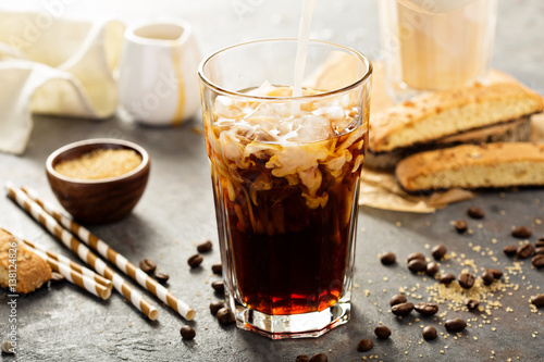 Fotografie, Obraz  Iced coffee being poured in a glass
