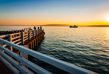 Ferry Arrives At Pier In Madel...