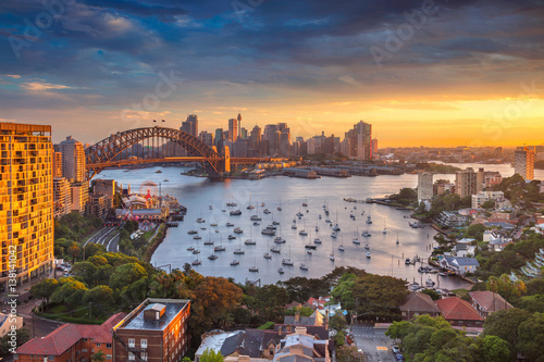 Poster Oceania Sydney. Cityscape image of Sydney, Australia with Harbour Bridge and Sydney skyline during sunset.