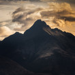 Mountain with looming cloud
