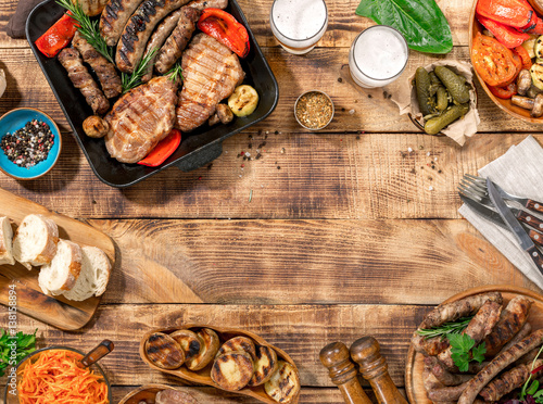 In de dag Grill / Barbecue Outdoors Food Concept. Barbecued steak, sausages and grilled vegetables
