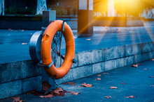 Orange Rescue Life Buoy By The Riverside In China.