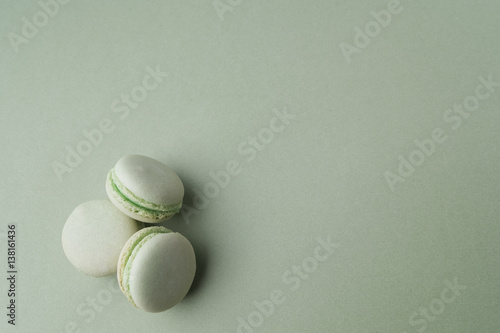 Green macarons on green background