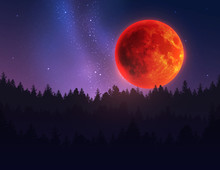 Big Red Moon In Night Sky Over...