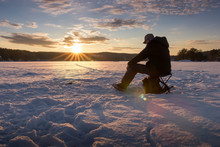 Ice Fishing On A Lake In Norwa...