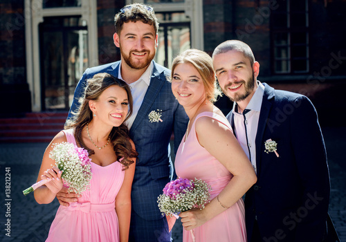 9bcf3b285b5 Handsome groomsmen pose with pretty bridesmaids in pink dresses ...