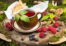 Raspberry Tea On A Stump In Th...