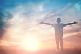 Man celebrating worship god in morning. Christian open hand over sunset inspire praise for peace cross concept for freedom financial, vision and mission, self motivation, hope faith love, stray