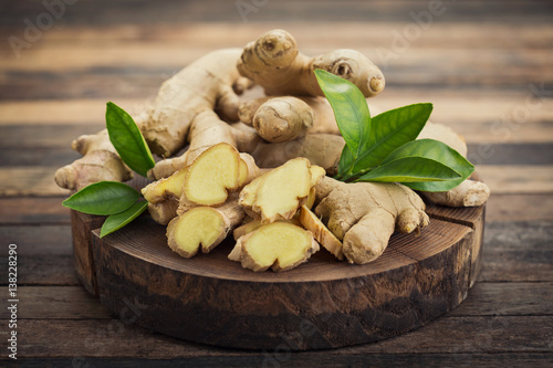 Fotografie, Obraz Fresh ginger root on the wooden table