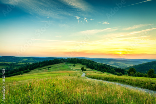Countryside aerial landscape with meadow and mountains