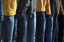 Several Mannequins Dressed In Winter Jackets And Jeans