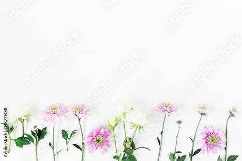 Foto op Canvas Bloemen Floral pattern with roses and pink flowers, green leaves and branches on white background. Flat lay, top view. Floral background
