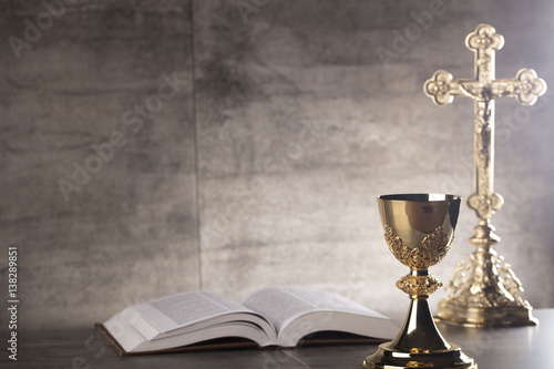Chalice, Bible and altar cross. Fototapet