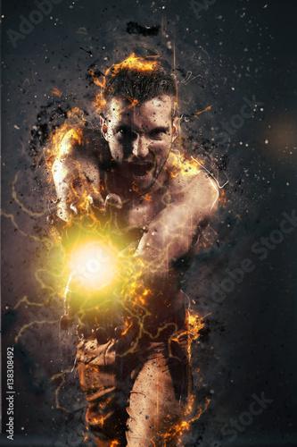 Fotografie, Obraz  Jeune homme musclé faisant une boule de feu