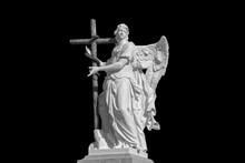 Angel Sculpture On A Black Background