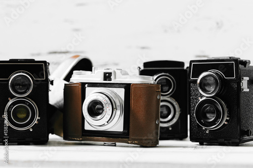 Stampe  collection old vintage retro photo cameras on white wooden background