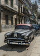 Vintage classic american car parked in a street of Old Havana,Cuba.