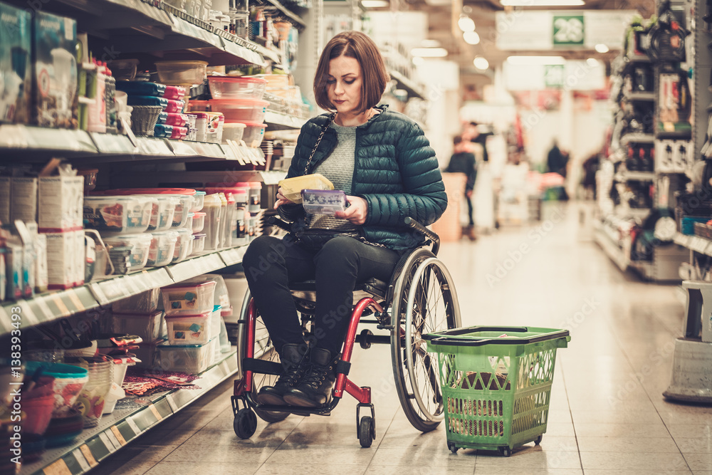 Fototapety, obrazy: Disabled woman in a wheelchair in a department store