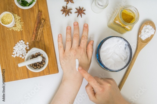 Photo  Woman is applying home made cream on hand