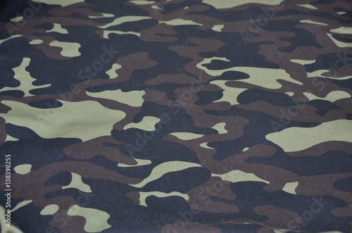 Texture Of Fabric With A Camouflage Painted In Colors Of The